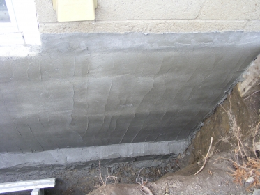 new-concrete-layer-on-foundation-wall